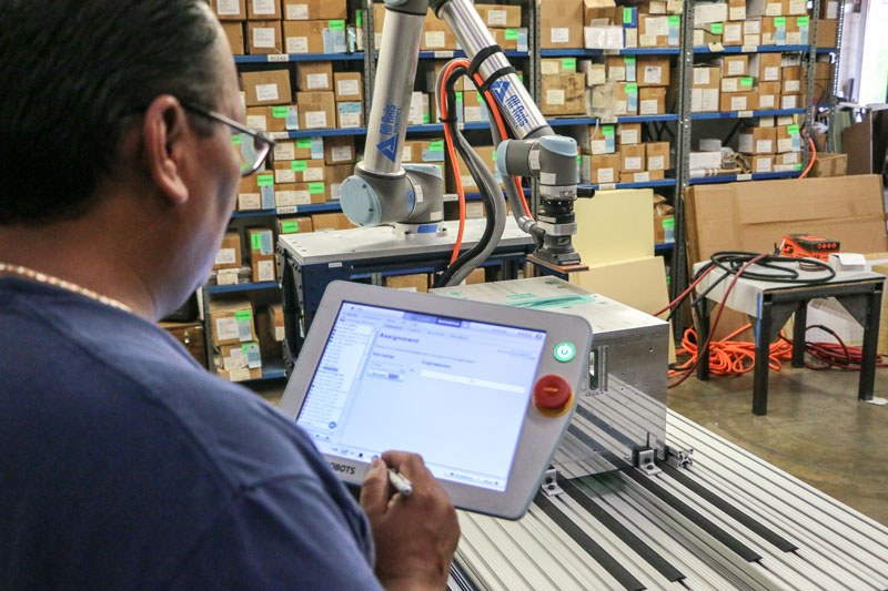Collaborative-robot-empowering-people-at-All-AXIS-Machining