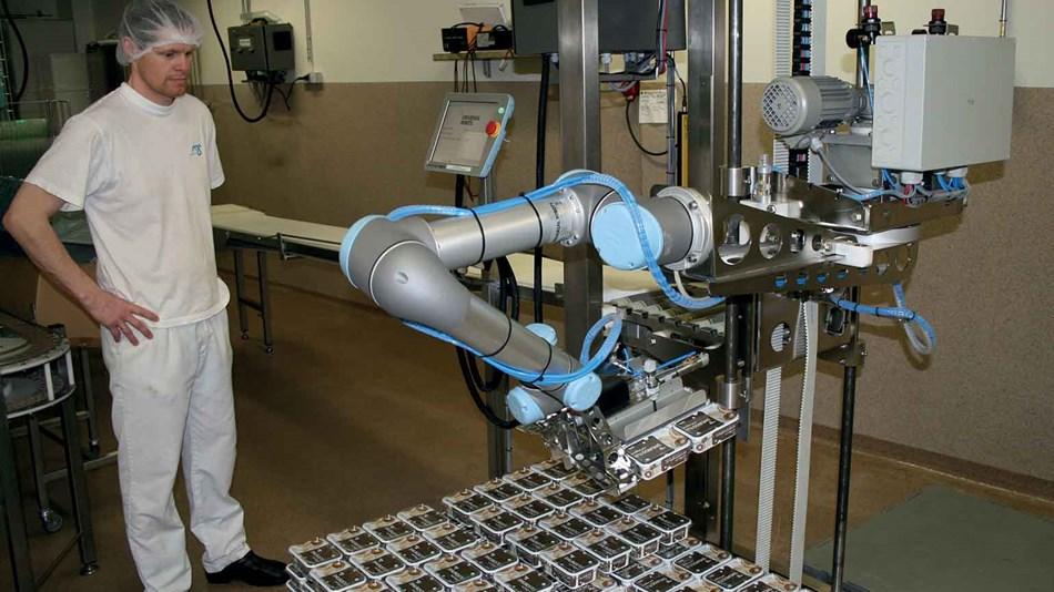 """Robô colaborativo sendo utilizado em uma fábrica de lacticínios da Islândia, no artigo """"Indústria 5.0"""""""